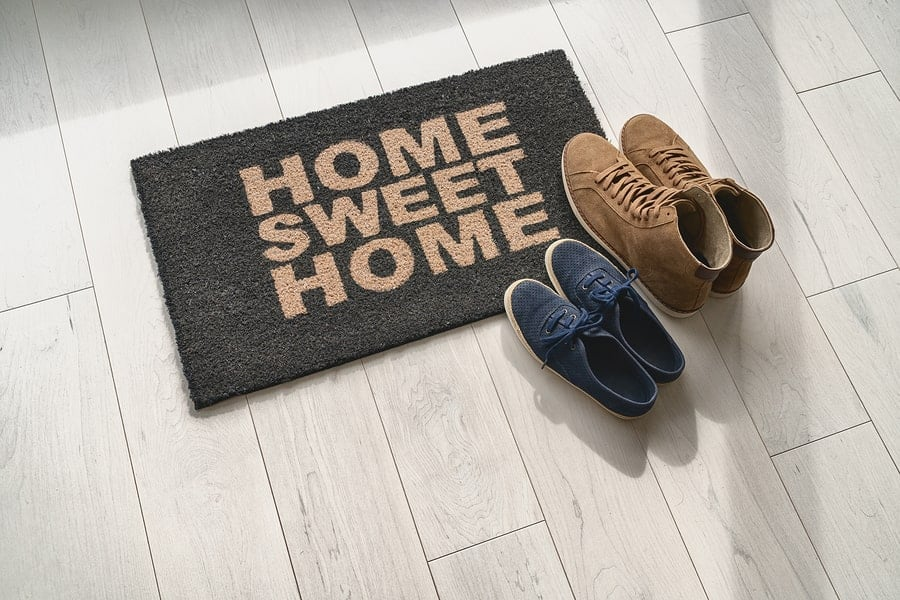 Home sweet home doormat with shoes beside