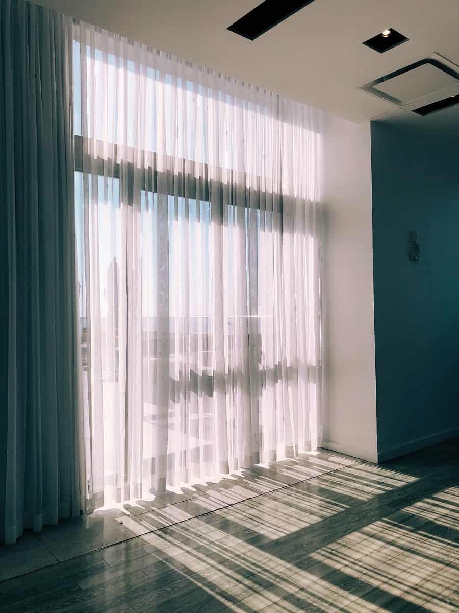sun shining through sheer translucent curtains