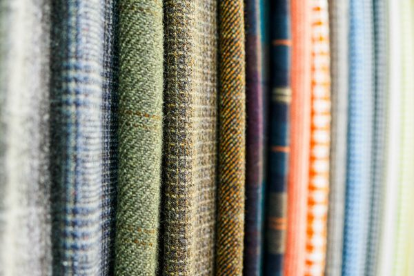 A large selection of bright plaid fabrics in the fabric store. Close-up of cellular tissue samples. Large collection of beautiful fabrics at the factory or in the store